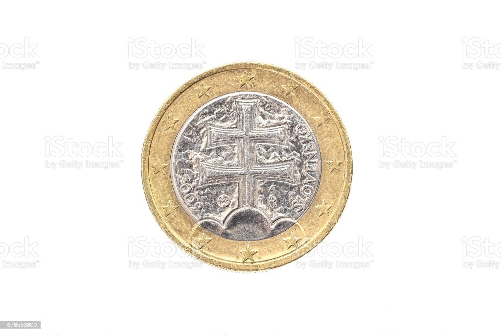 Old used and worn out 1 euro coin. stock photo
