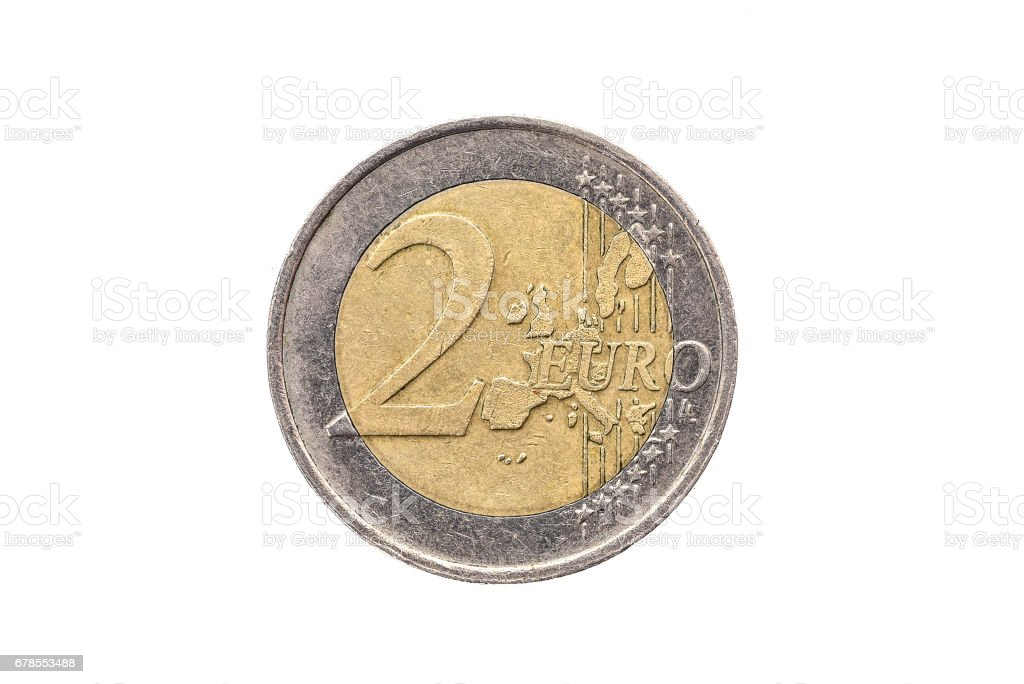 Old used and worn out 2 euro coin. stock photo