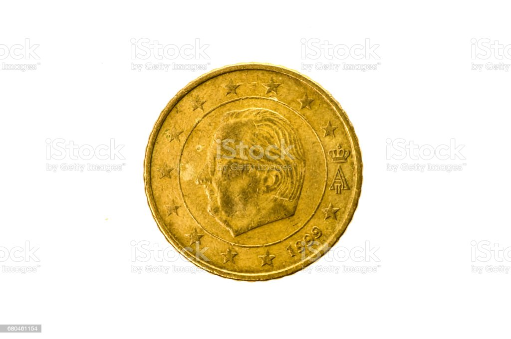 Old used and worn out 50 cents coin. stock photo