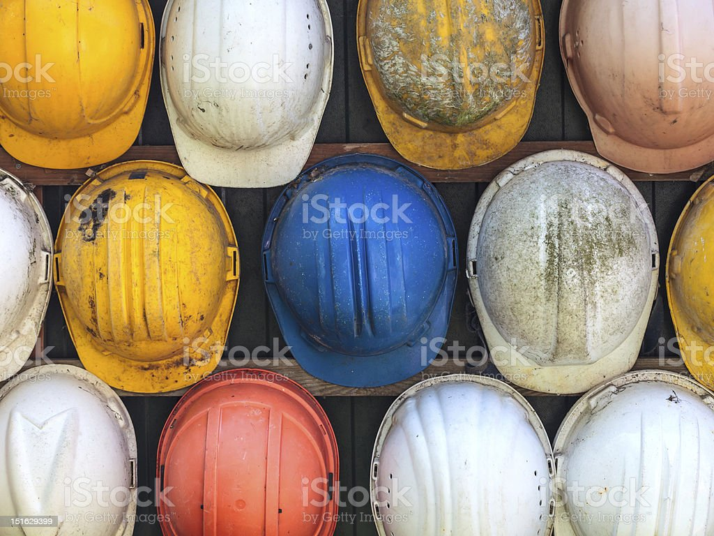 Old used construction helmets stock photo