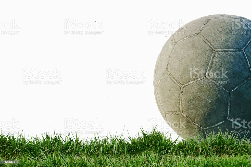 Old used football or soccer ball on cracked asphalt royalty-free stock photo