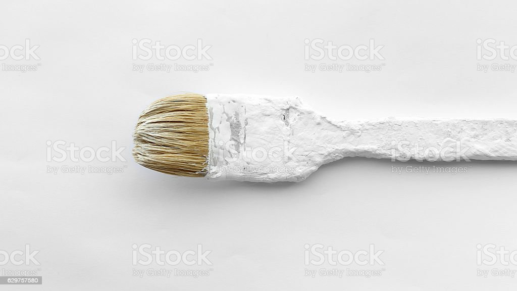 Old used paint brush closeup stock photo