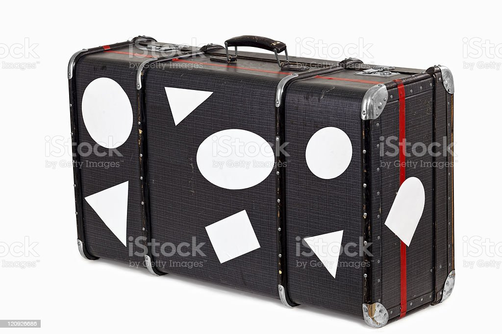 Old Used Suitcase With blank Travel Stickers stock photo
