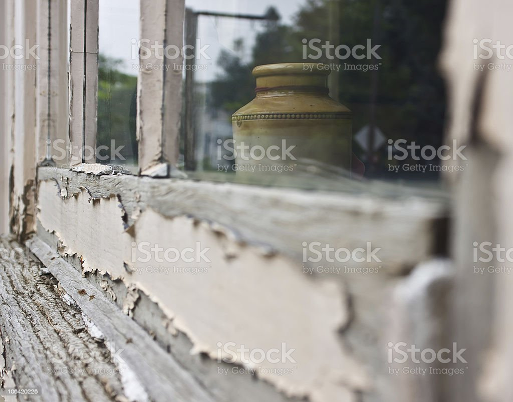 Old Vase in Weathered Window royalty-free stock photo