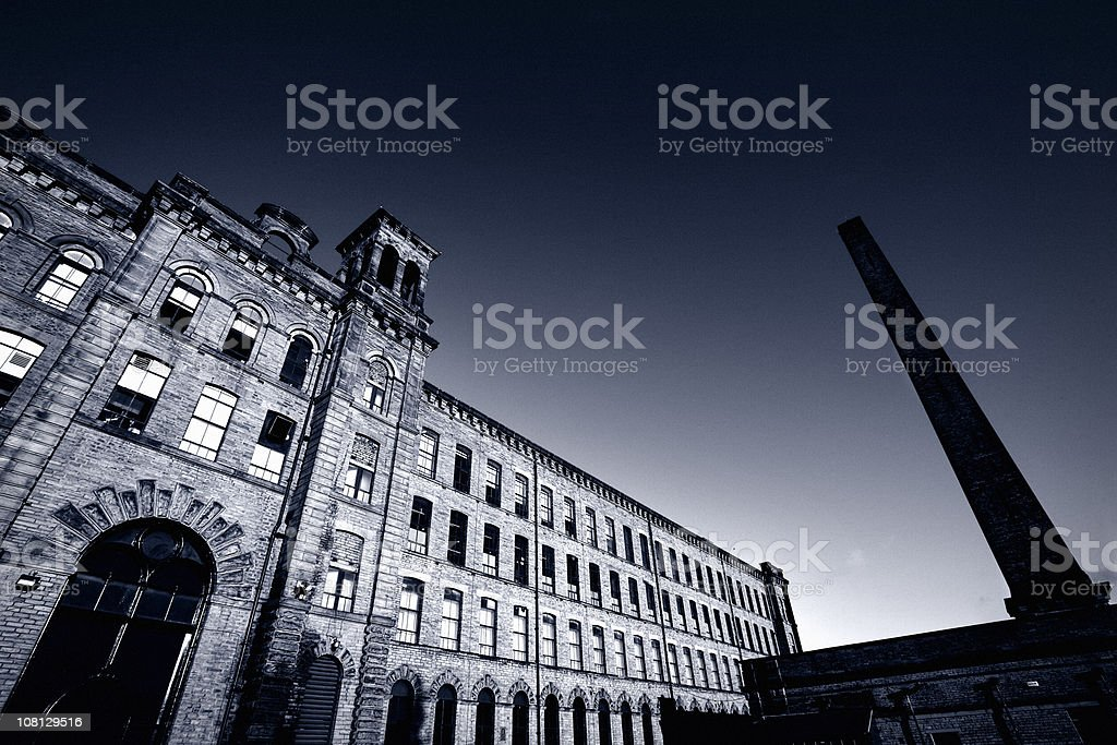 Old Victorian Textile Mill at Sunset stock photo