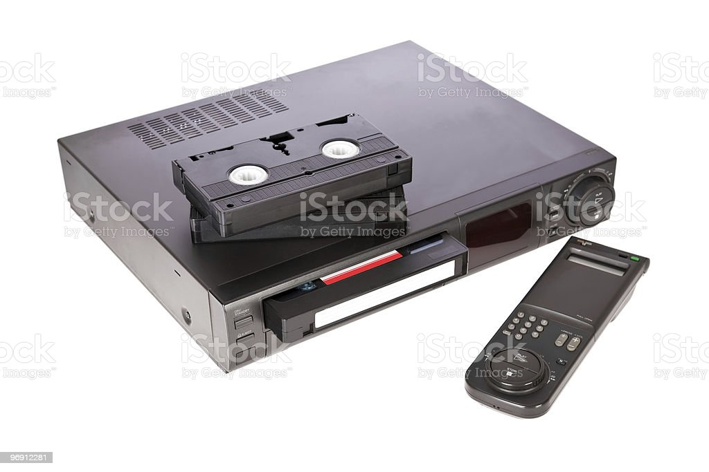 Old Video Cassette Recorder and tapes isolated on white stock photo