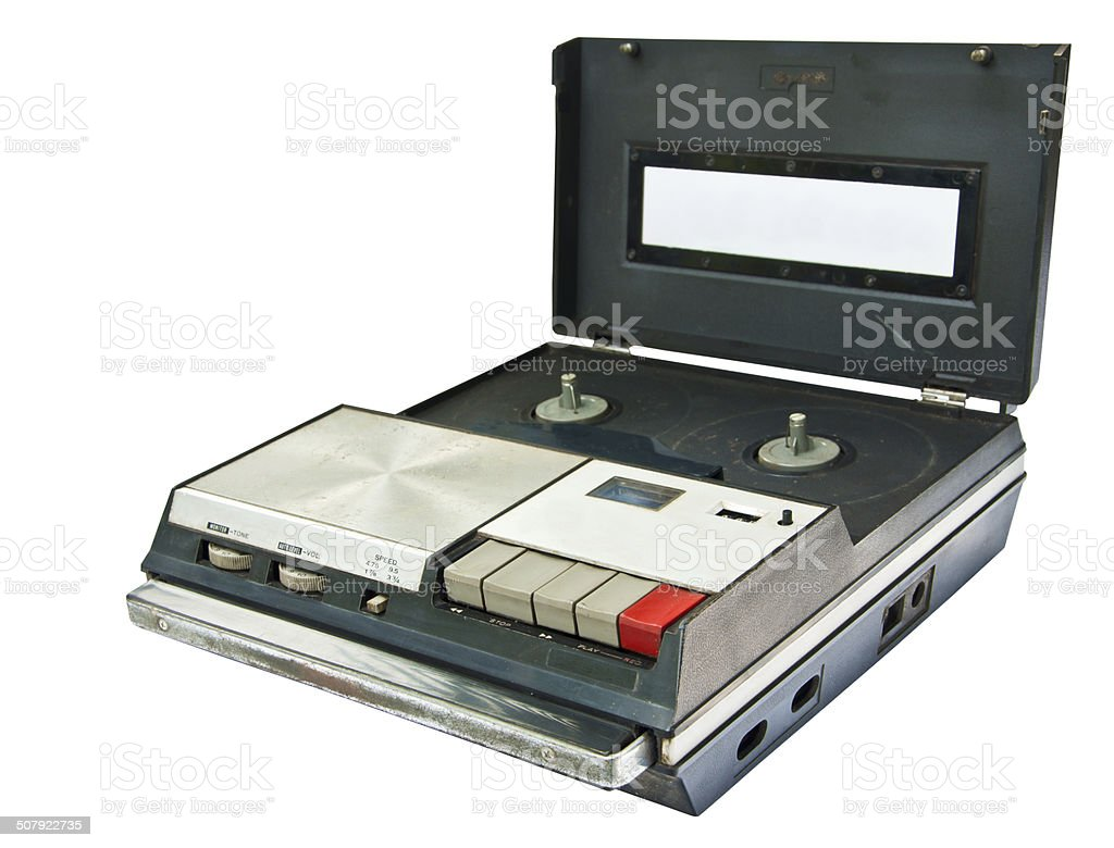 Old Video Cassette Recorder ejecting isolated on white background stock photo