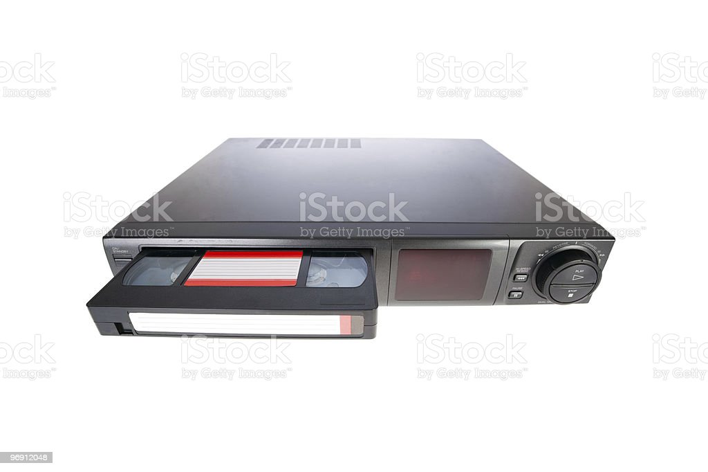 Old Video Cassette Recorder ejecting tape isolated on white stock photo