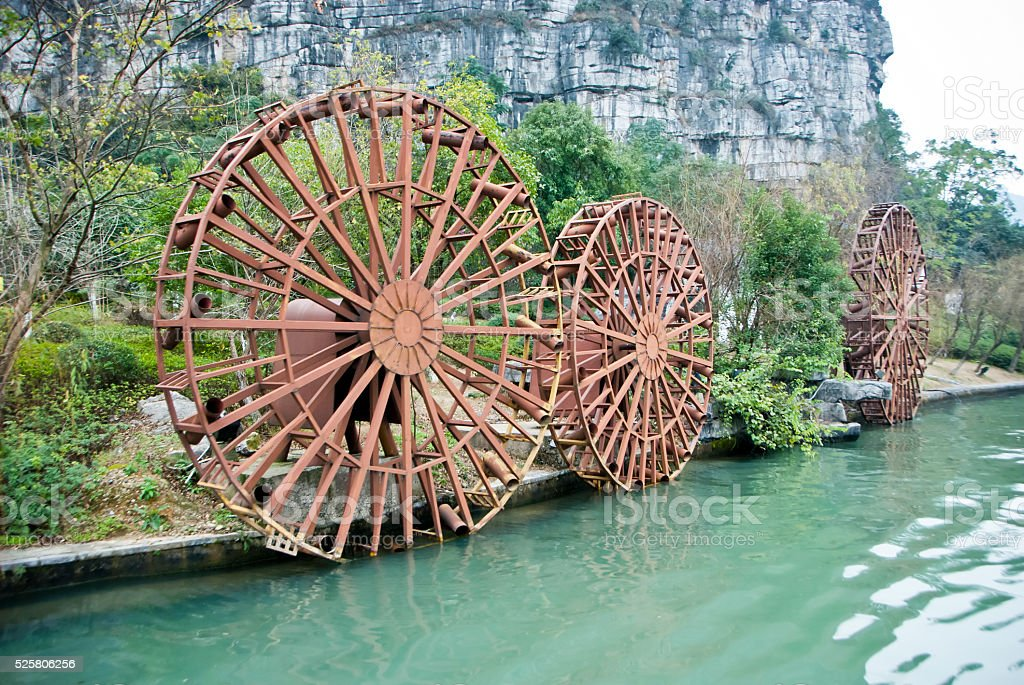 Old village water mill and water wheel stock photo