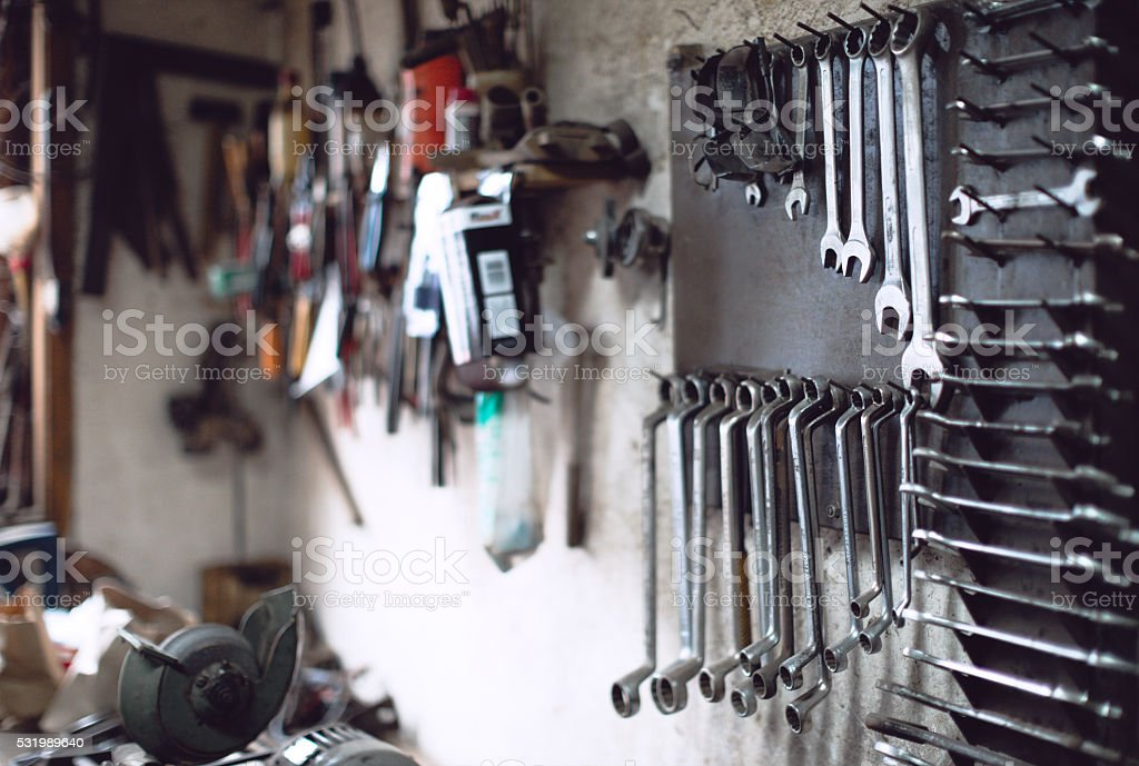 Old vinrtage tools on the wall stock photo