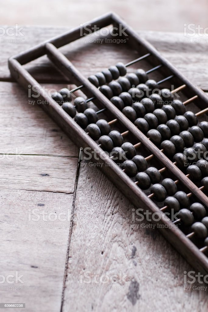 Old vintage abacus on wooden table stock photo
