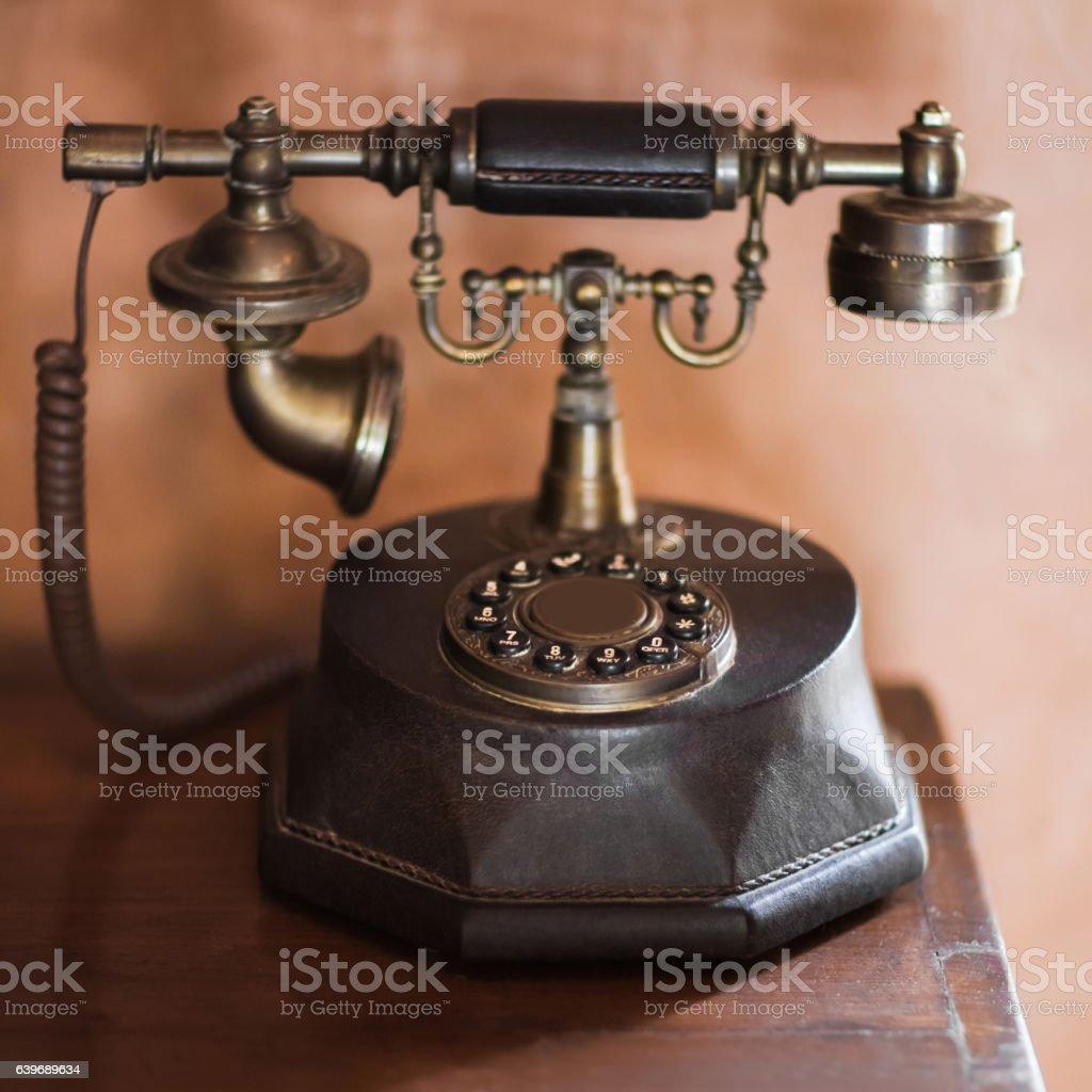 Old vintage antique bronze phone stock photo