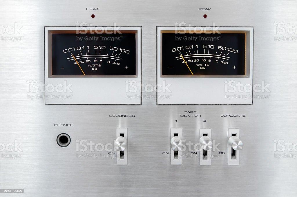 Old vintage audio amplifier facade with vu meter needles stock photo