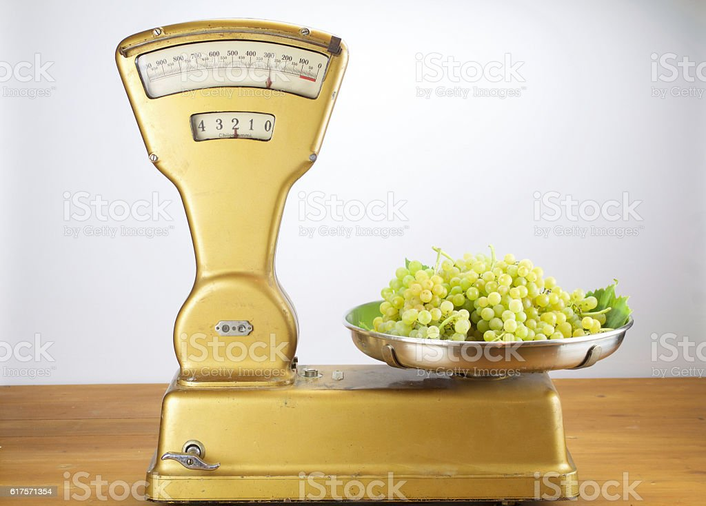 Old vintage balance with two Kilograms of muscat grapes stock photo