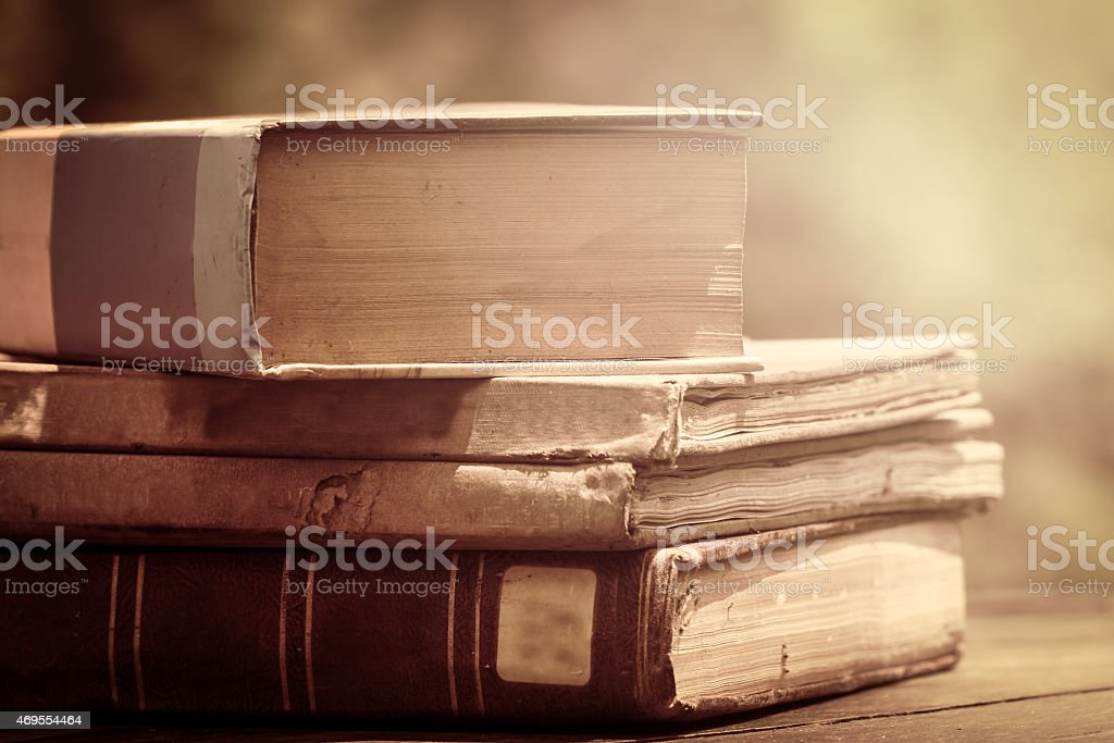 Old vintage books on wooden desk in retro style stock photo