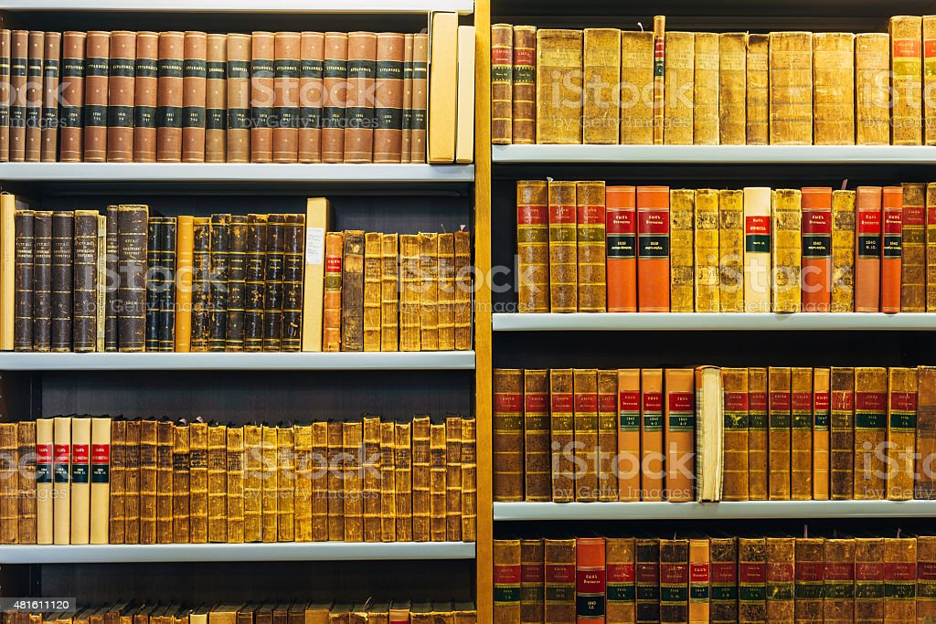 Old Vintage Books On Wooden Shelfs In Library stock photo