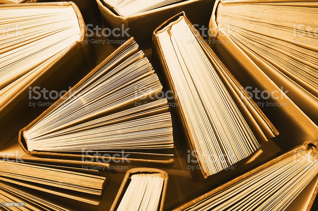 Old vintage books stood slightly fanned open from above royalty-free stock photo