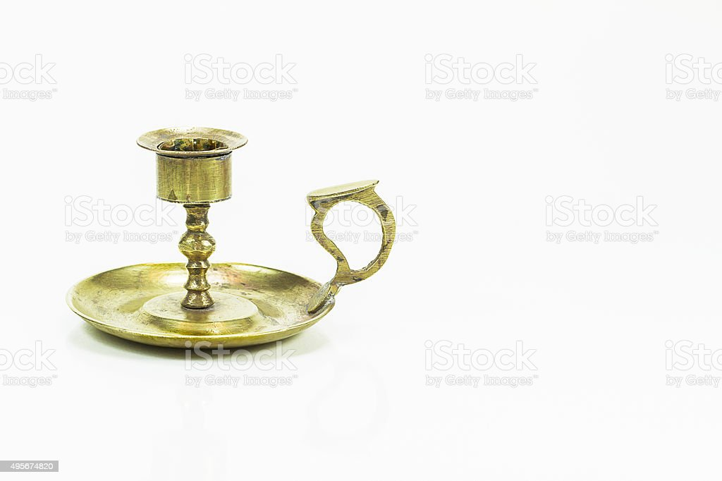 Old vintage brass candle stick, holder on white background stock photo