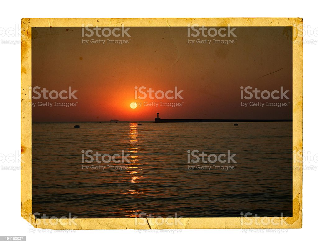Old vintage card with a beautiful sea sunset stock photo