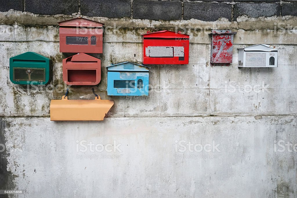 old vintage colorful post box stock photo