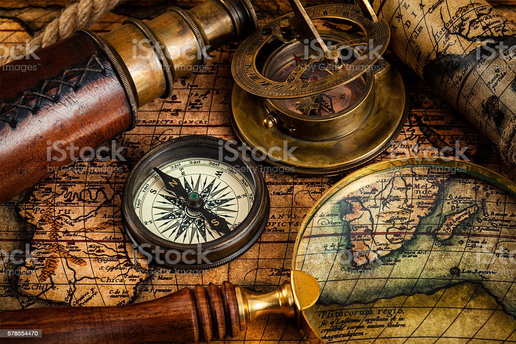 Old vintage compass and travel instruments on ancient map stock photo