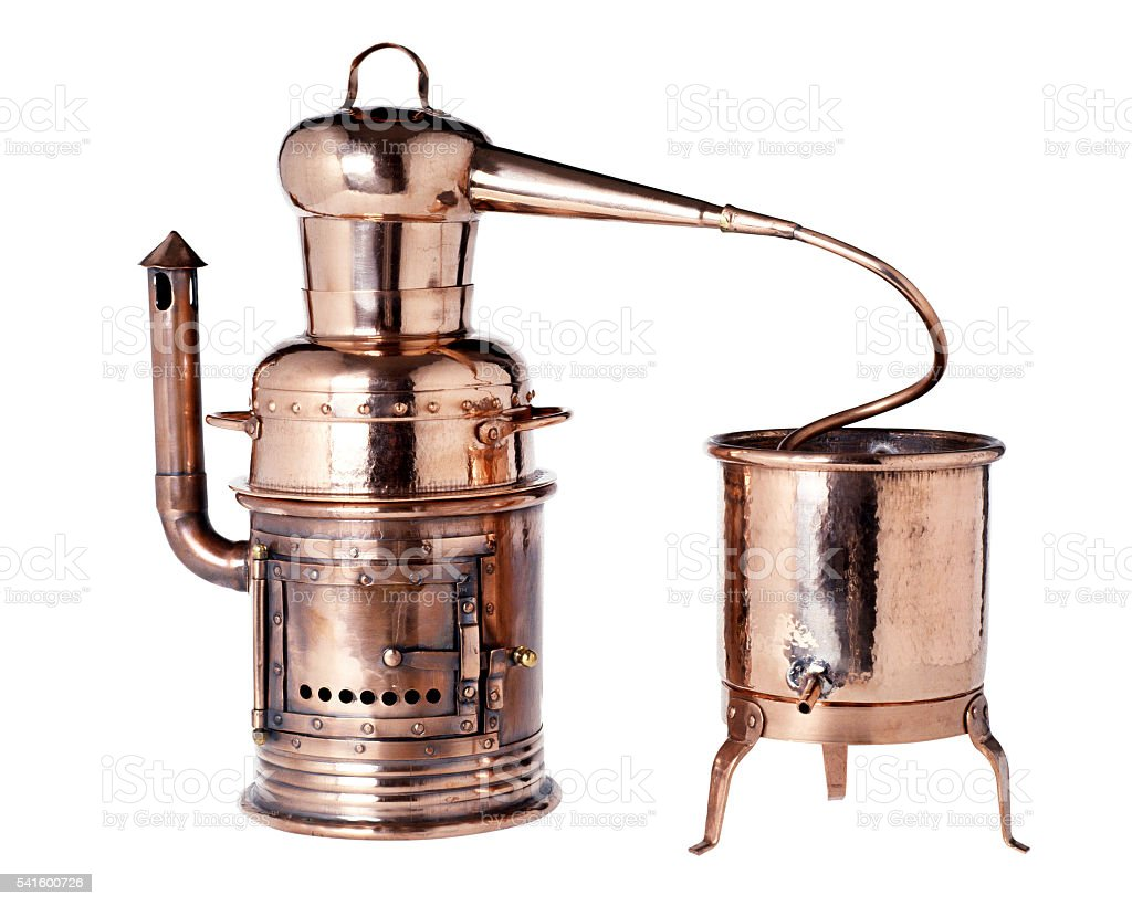 Old vintage copper alembic stock photo