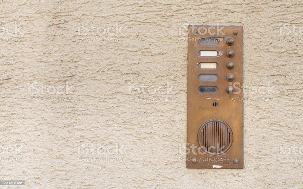 Old vintage door bell with intercom stock photo