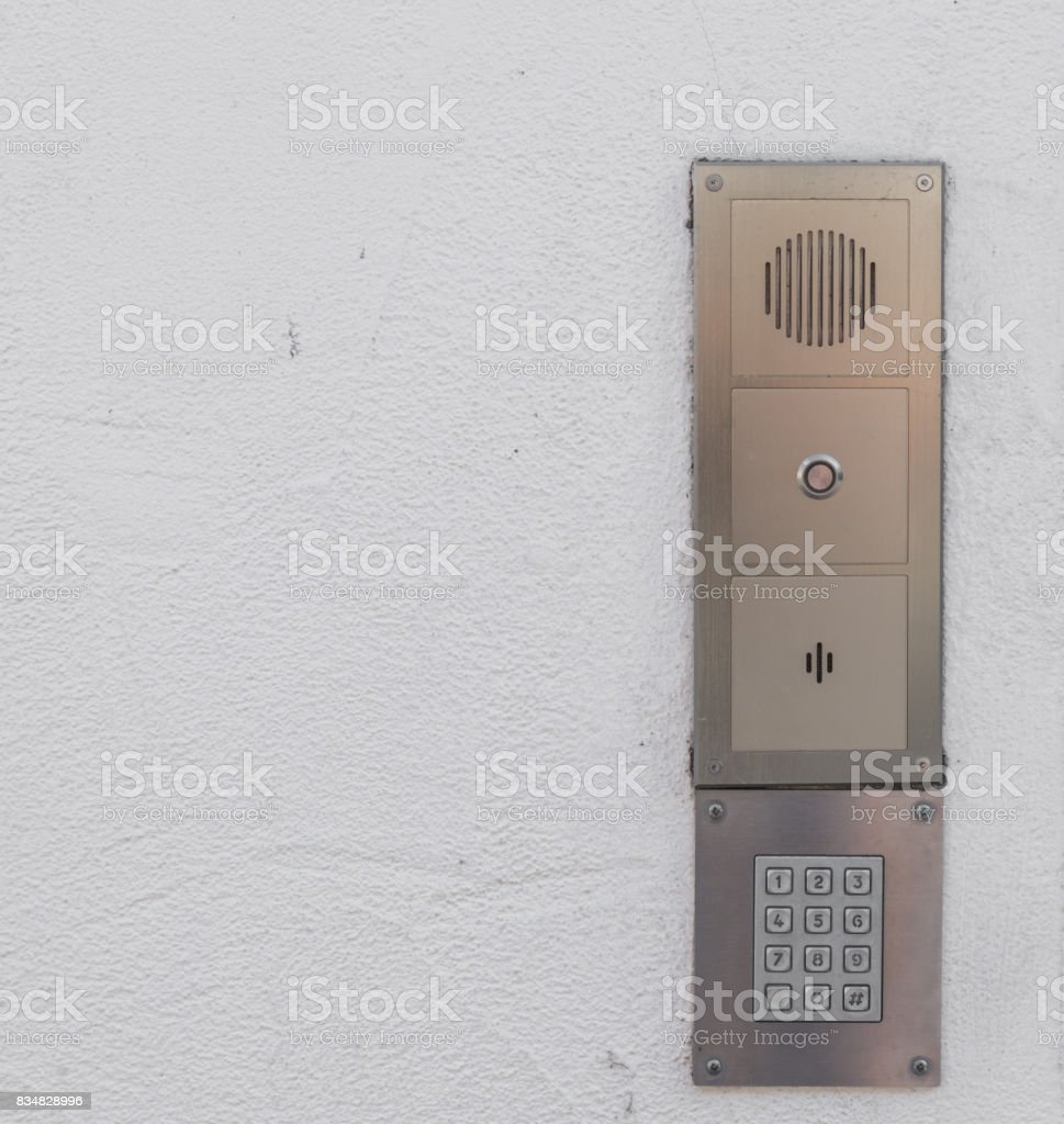 Old vintage door bell with intercom stock photo