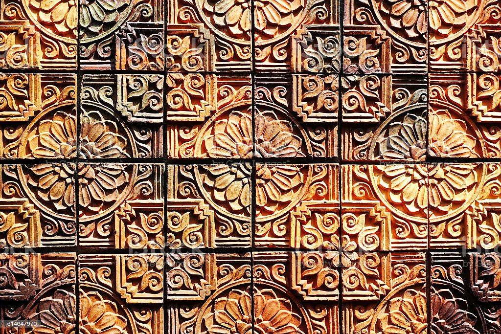 Old vintage earthenware wall tiles patterns handcraft from thailand public. stock photo