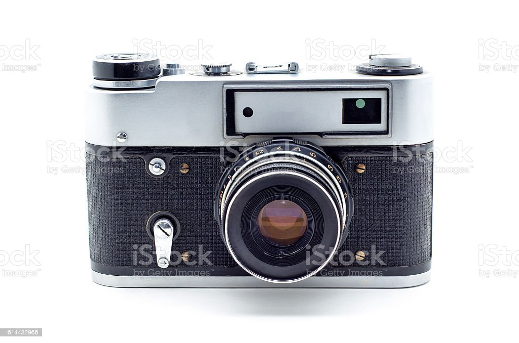 Old vintage film photographic camera isolated on white backgroun stock photo