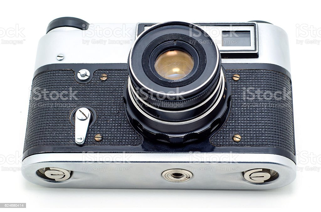 Old vintage film photographic camera isolated on white. stock photo