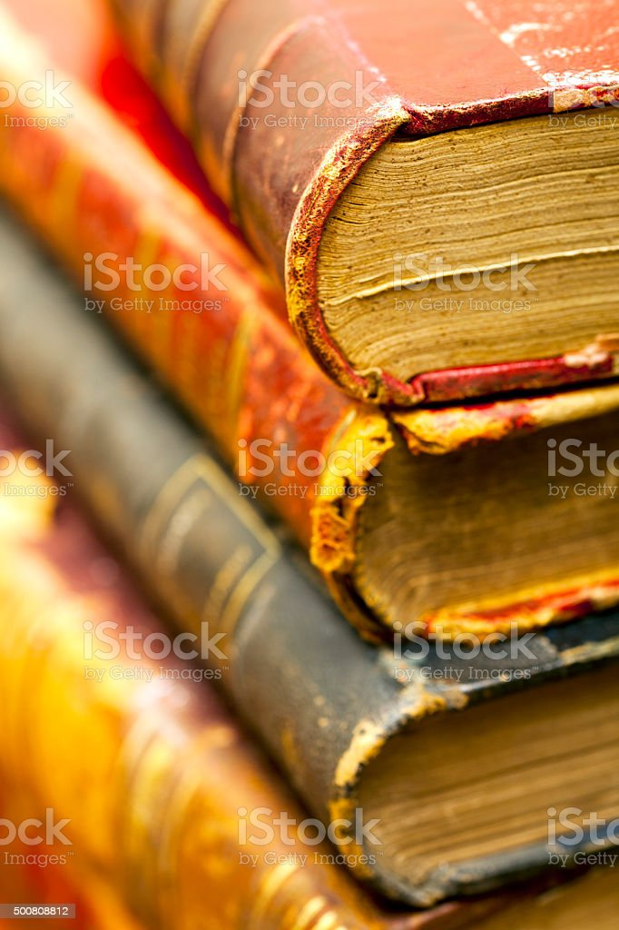 Old vintage leather binded booksp ile stock photo
