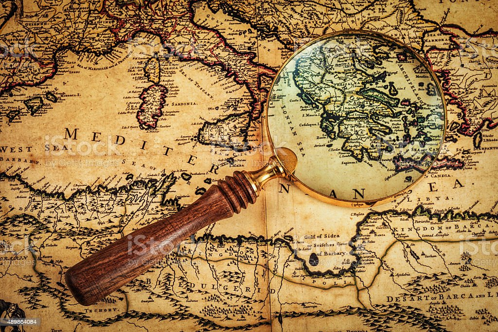 Old vintage magnifying glass on ancient map stock photo