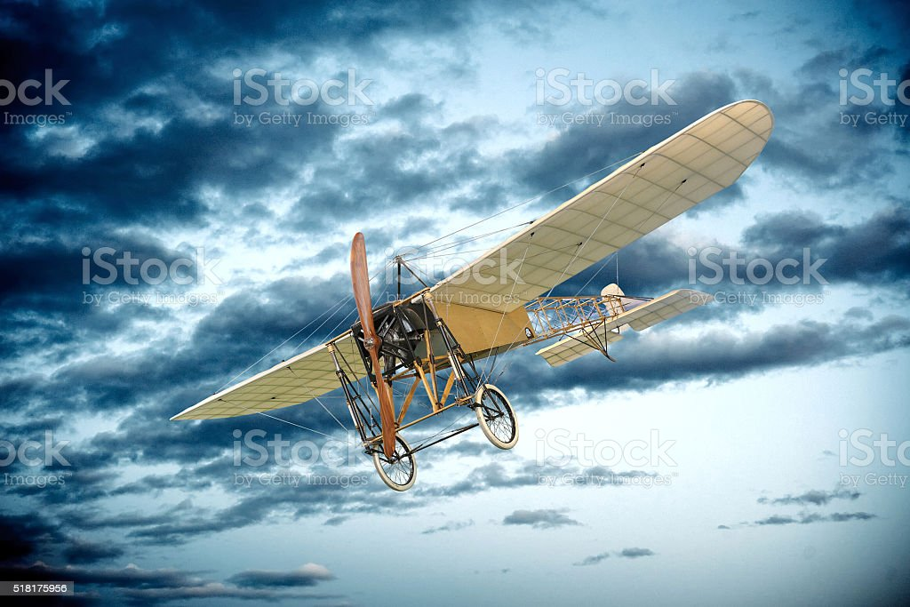 Old vintage mono plane flying in an evening sky stock photo