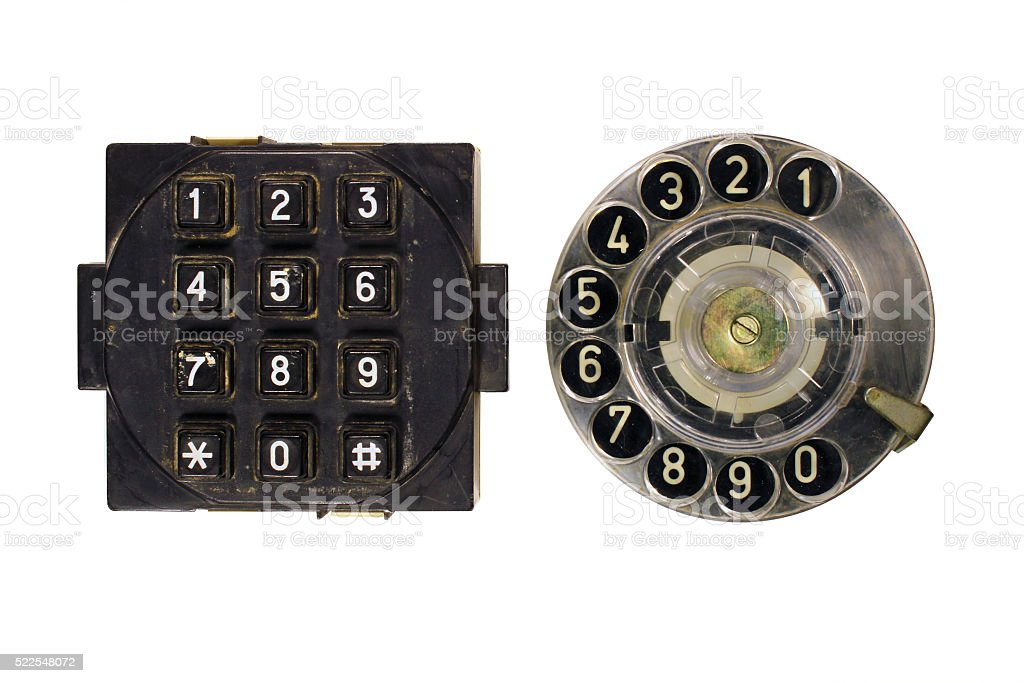 Old vintage phone dial and button keypad isolated on white stock photo