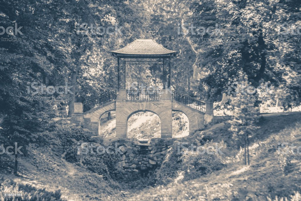Old vintage photo. Chinese-style bridge stock photo