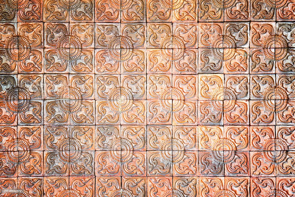 Old vintage pottery tiles wall texture background stock photo