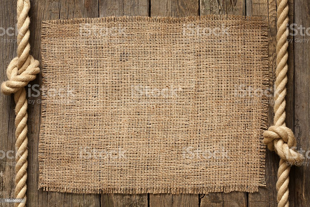 Old vintage rope and planks background with jute royalty-free stock photo