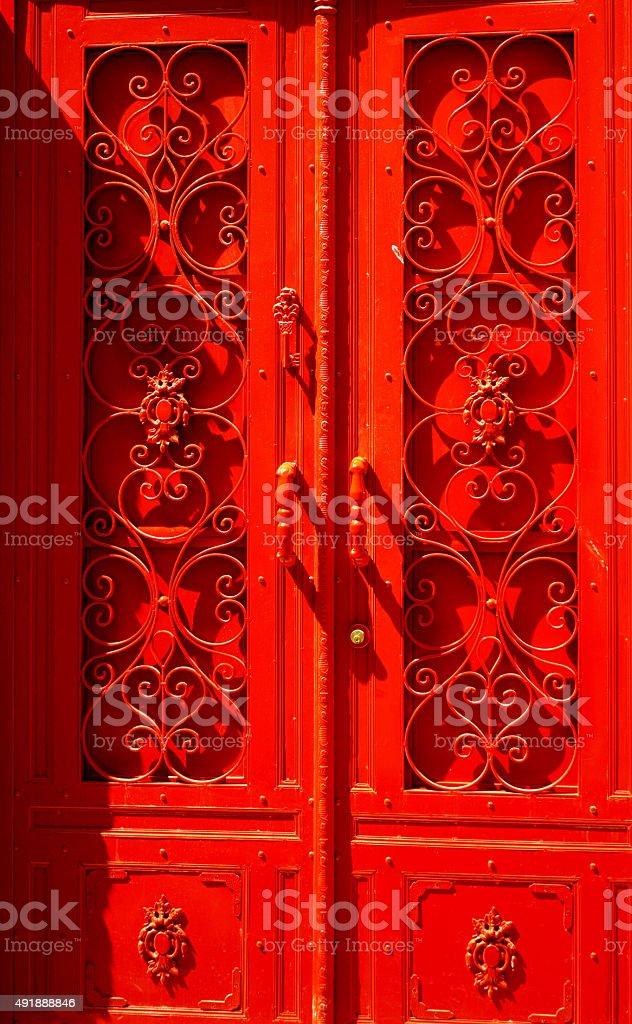 Old vintage rustic exterior red door detail stock photo