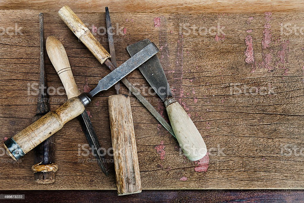 Old vintage rusty carpenter tools on grunge wooden background stock photo