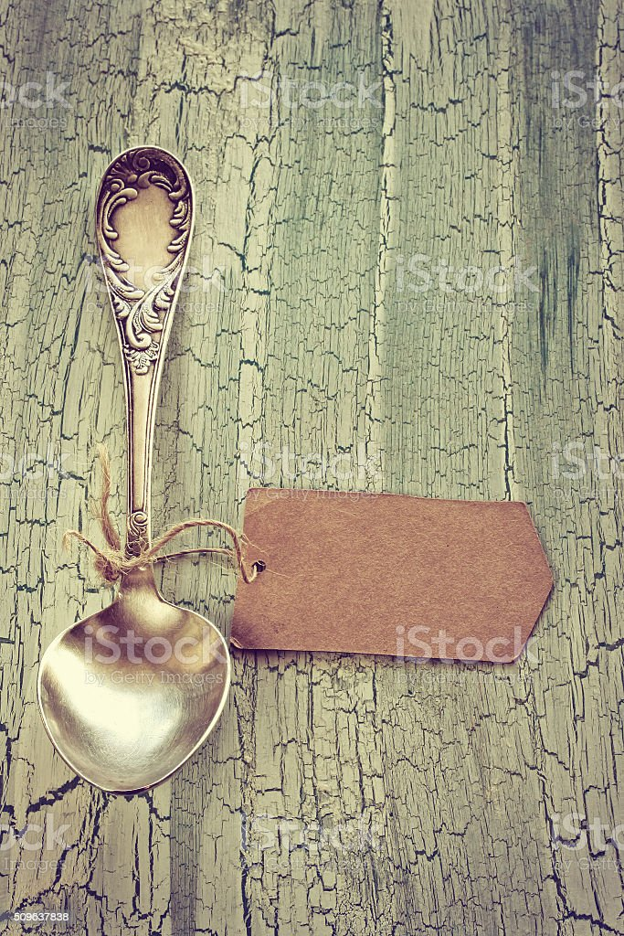 old vintage spoon with paper tag stock photo
