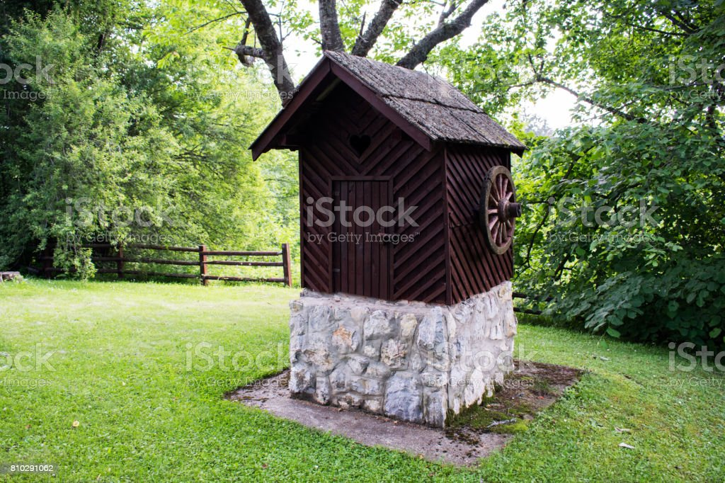 Old Vintage Stone Well. Ethno Village. stock photo