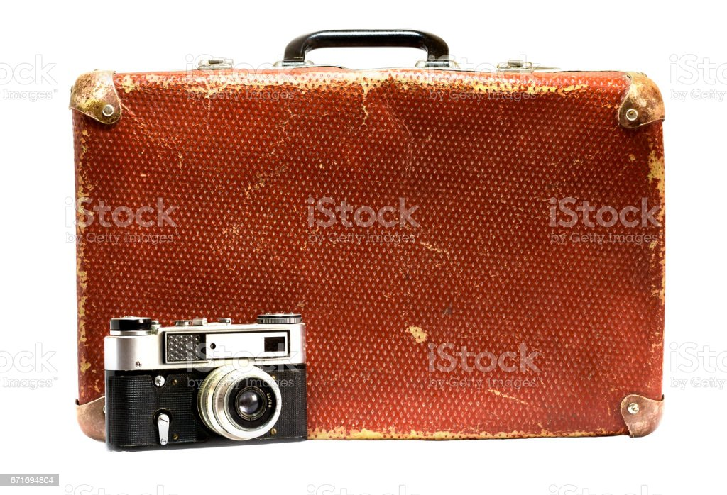 Old vintage suitcase and old camera on a white background. stock photo