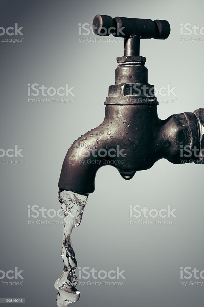 Old Vintage tap with flowing water stock photo
