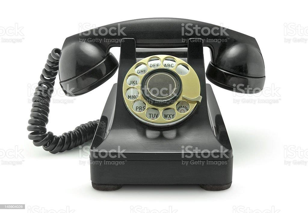 Vieux téléphone sur blanc Vintage photo libre de droits