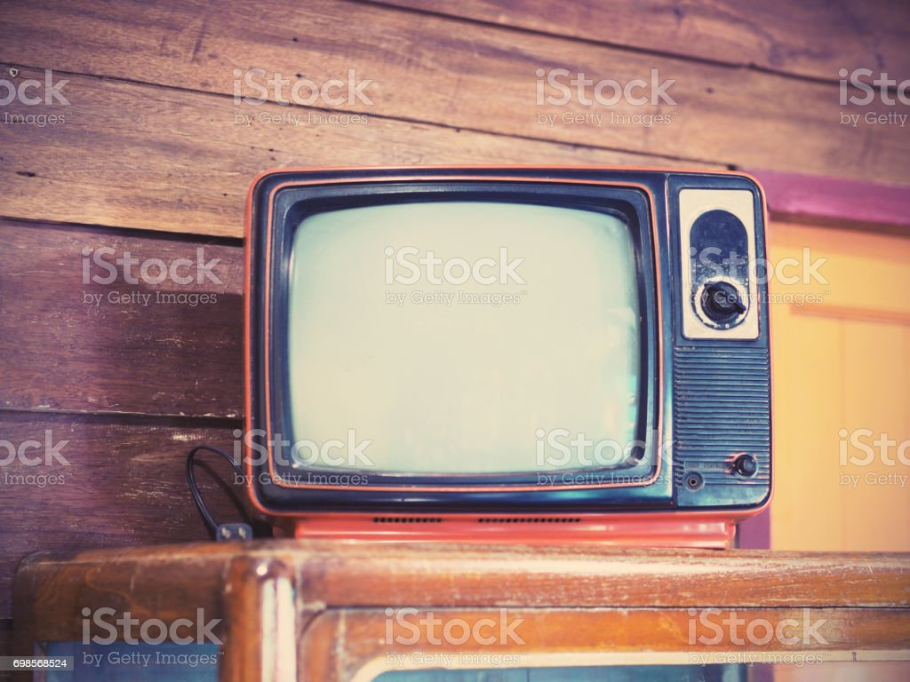 Old Vintage Television On Cabinet At Wooden House Filter Effect Royalty Free Stock