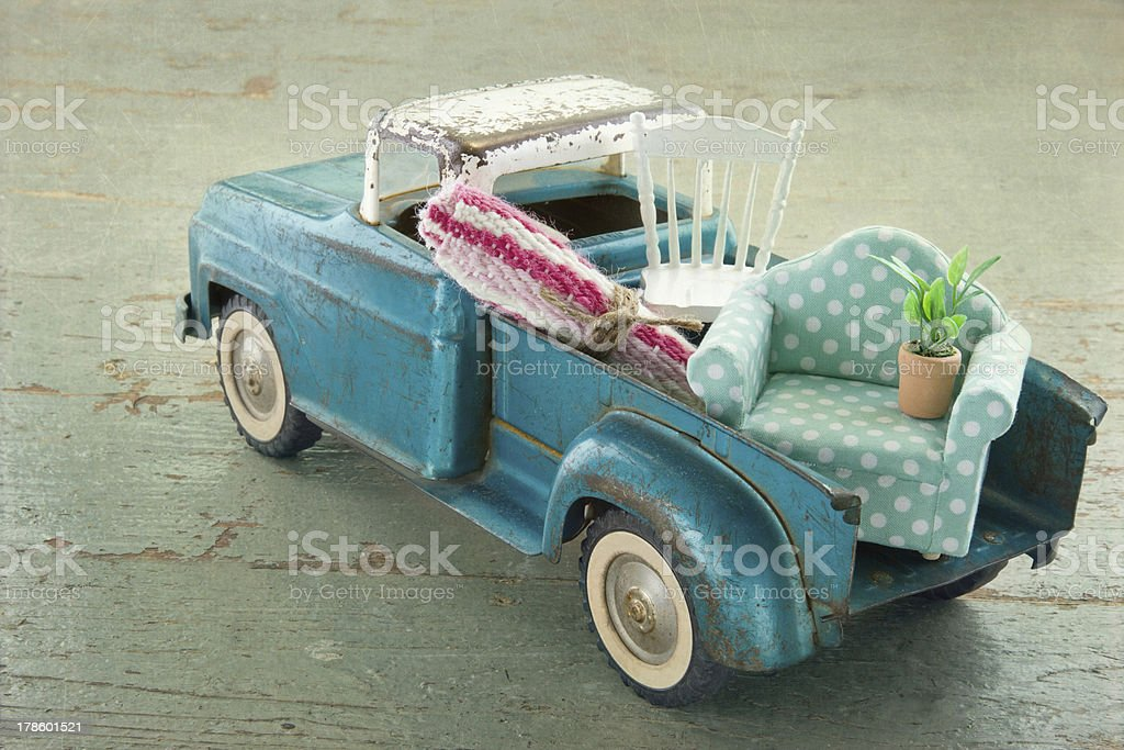 Old vintage toy truck on wooden background stock photo