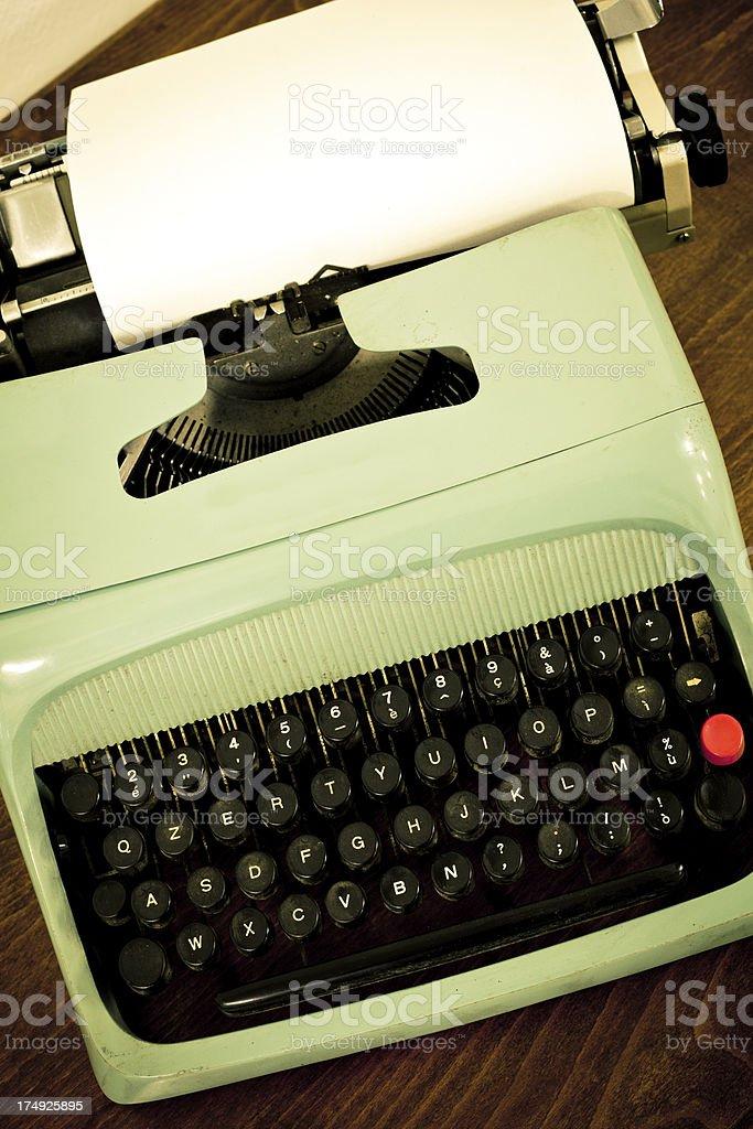 Old Vintage Typewriter and White Sheet of Paper royalty-free stock photo