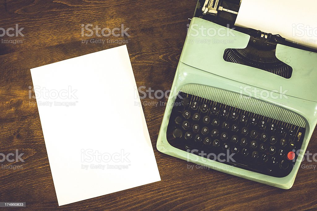 Old Vintage Typewriter with White Sheet of Paper royalty-free stock photo