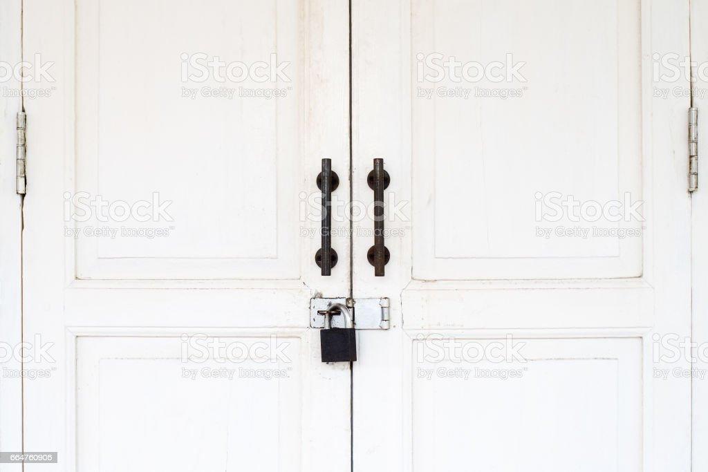 Old vintage white door with lock stock photo